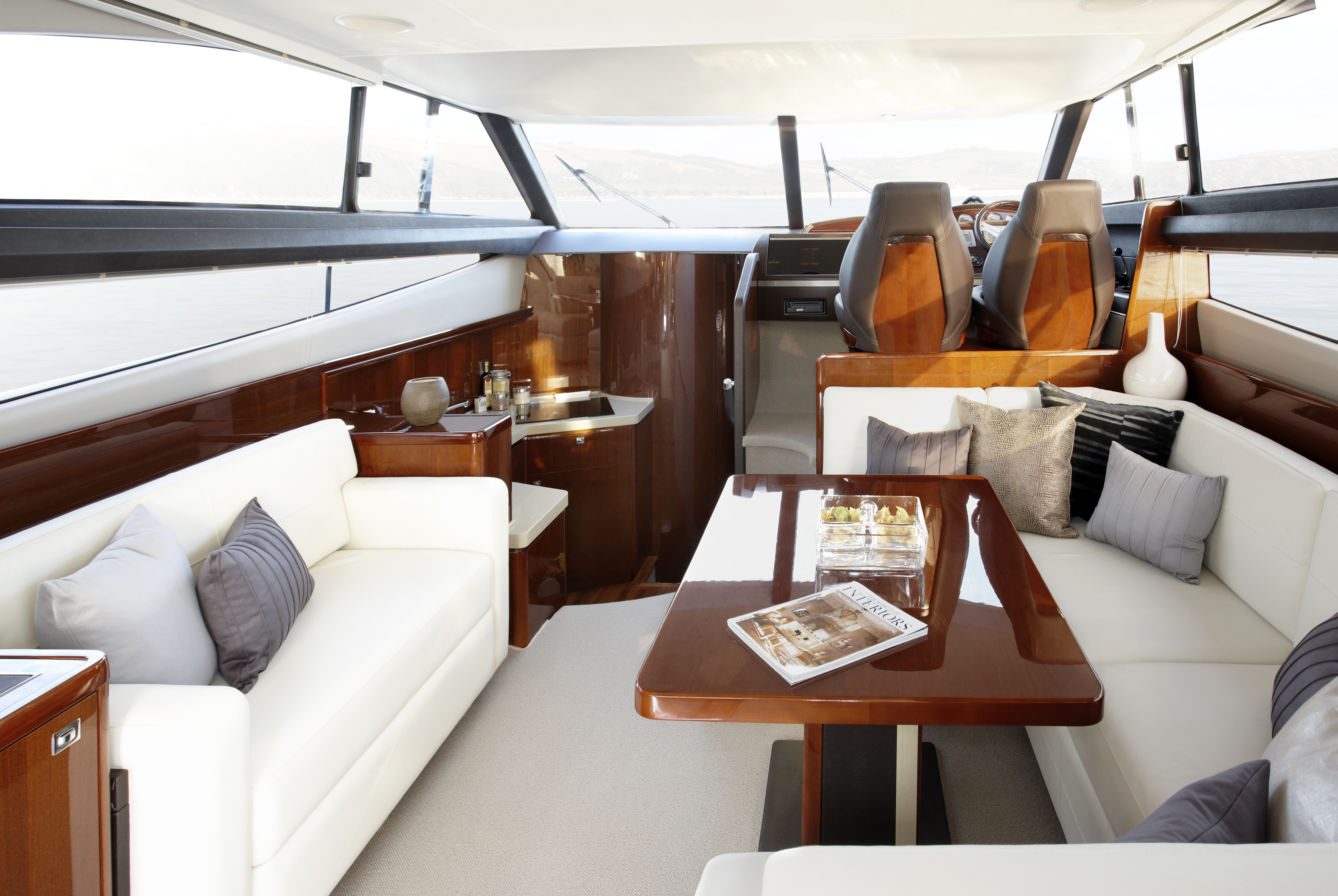 Princess 42 Flybridge. Inside, the sense of space is enhanced by the ...